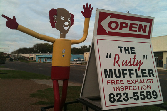 street side sign with muffler man